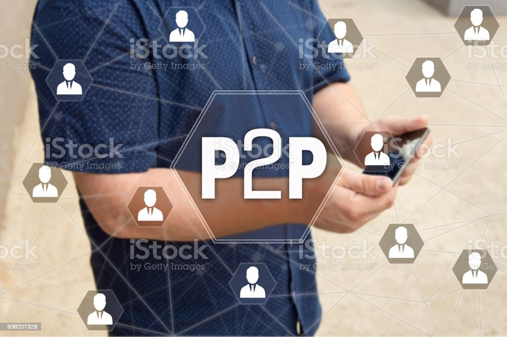Peer to peer. P2P on the touch screen with a blur background of the businessman with the phone.The concept of Peer to peer, P2P stock photo