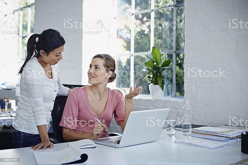 Peers discussing program stock photo