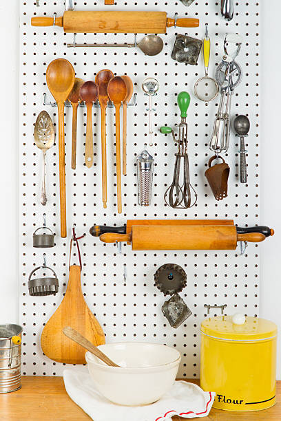 Pegboard Filled with Old Cooking Gadgets stock photo