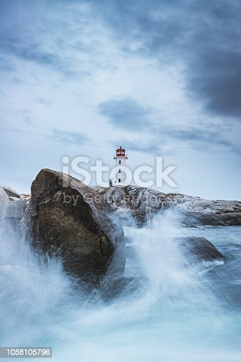 Waves breaking on the rocks in front of the Peggy's Cove lighthouse in Nova Scotia.