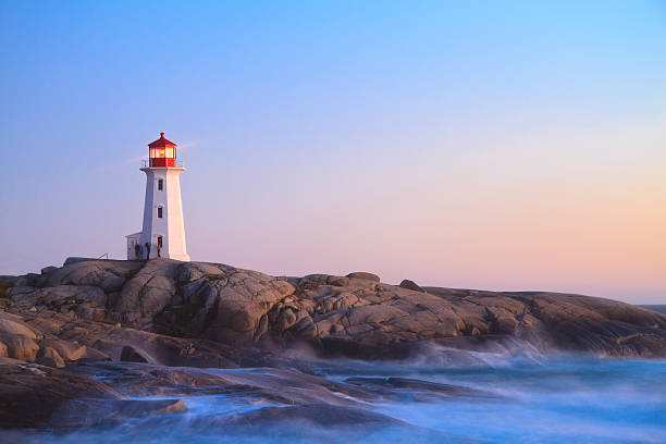 Peggy`s Cove Lighthouse at Dusk  bay of water stock pictures, royalty-free photos & images