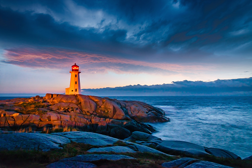 Peggys Cove Lighthouse Dramatic Sunset Twilght Nova Scotia Canada Stock Photo - Download Image Now