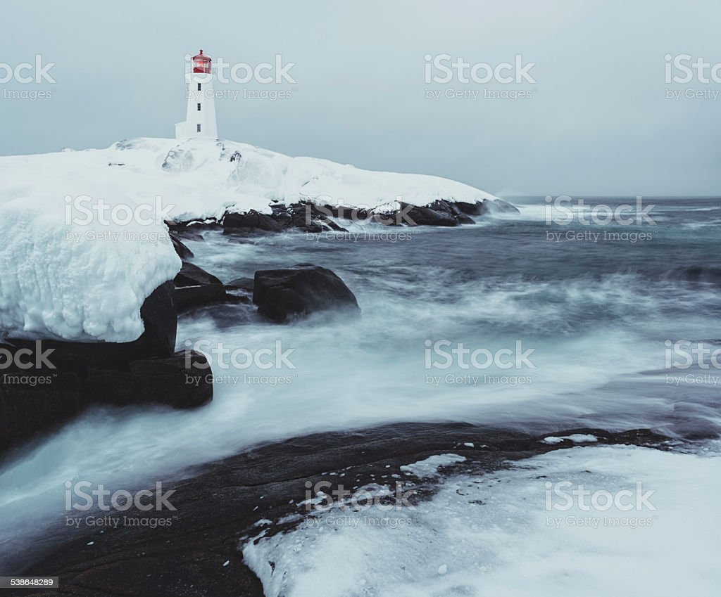 Peggy's Cove Lighthouse on Ice stock photo
