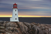 Iconic Peggy's Cove Lighthouse in evening light.