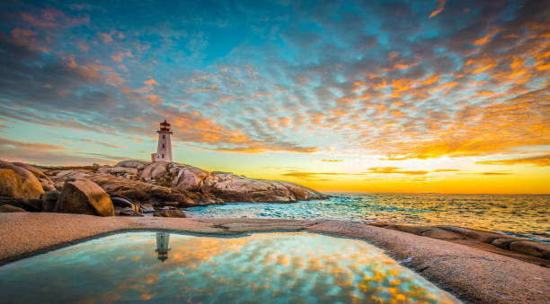 Peggy's cove lighthouse sunset ocean view landscape in Halifax, Nova Scotia stock photo