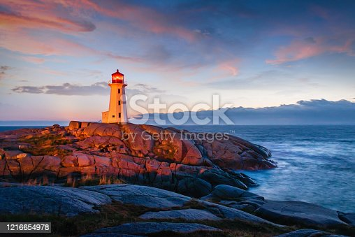 Famous Peggy's Cove Lighthouse at Sunset Twilight. Peggy's Cove, Nova Scotia, Canada.