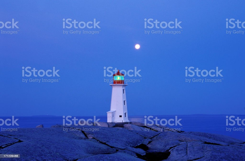 Peggy's cove lighthouse with a full moon royalty-free stock photo