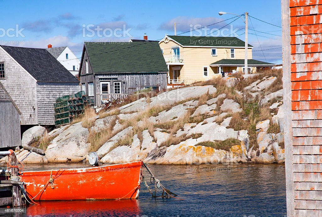 Peggy's Cove With Red Boat and Fisherman's Houses stock photo