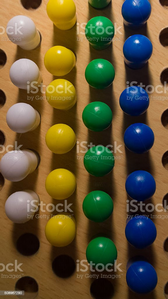 Pegs in a Board From Above - Vertical stock photo