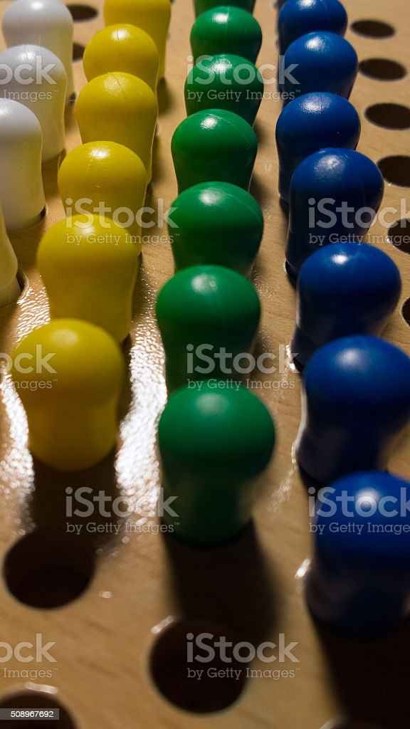 Pegs in a Board Surface Level stock photo