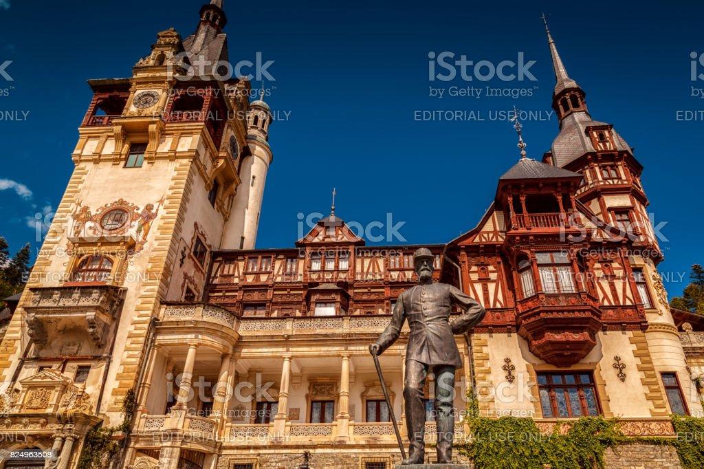 Peles Castle and Charles I statue in Sinaia, Romania stock photo