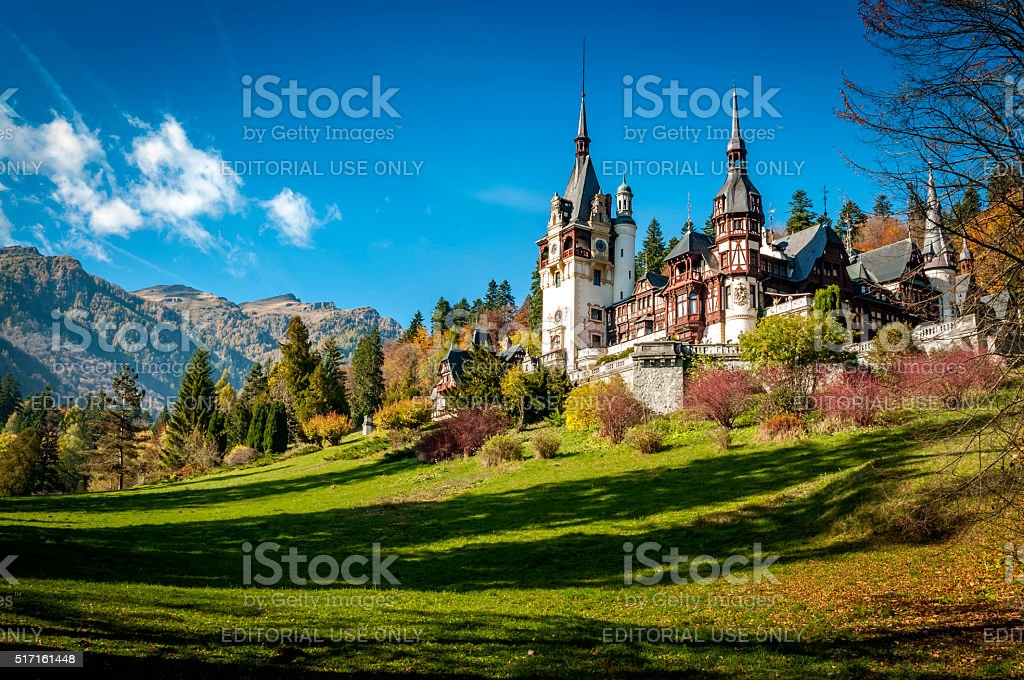 Peles Castle in Sinaia, Romania on a sunny fall day stock photo