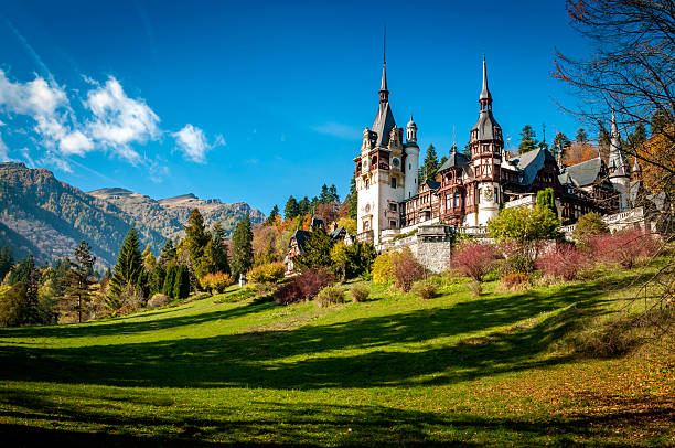 peles castle in sinaia, romania on a sunny fall day - romania stock pictures, royalty-free photos & images
