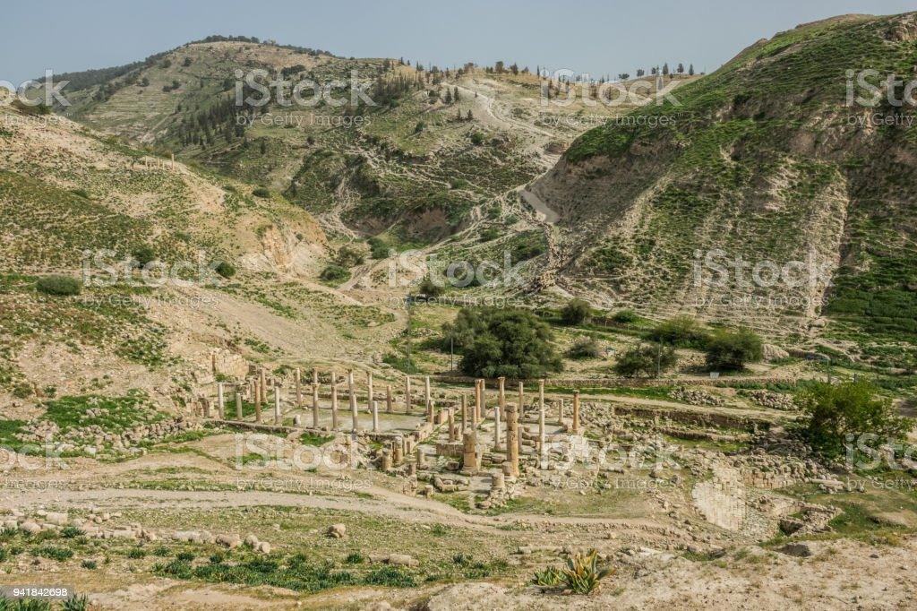 Pella ruins columns near the mountains stock photo
