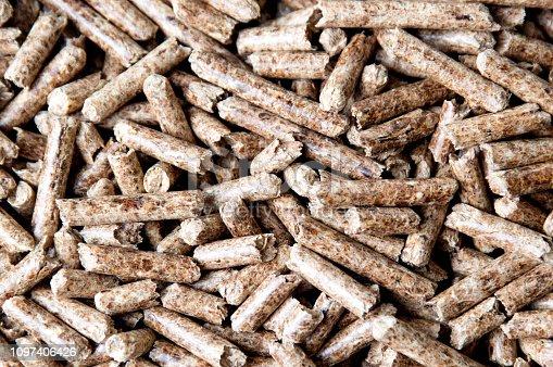 istock Pellet sticks used for heat background 1097406426