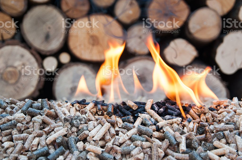 Pellets in flames stock photo