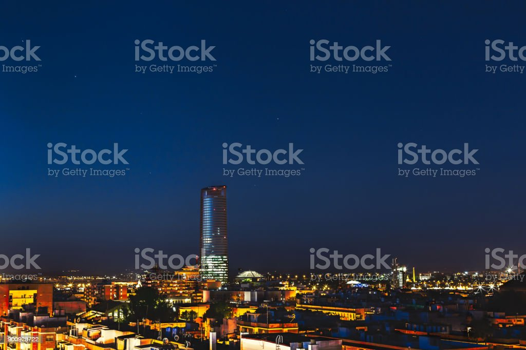 Pelli Tower at night. View from the traditional neighborhood of Triana in Seville, Spain. stock photo