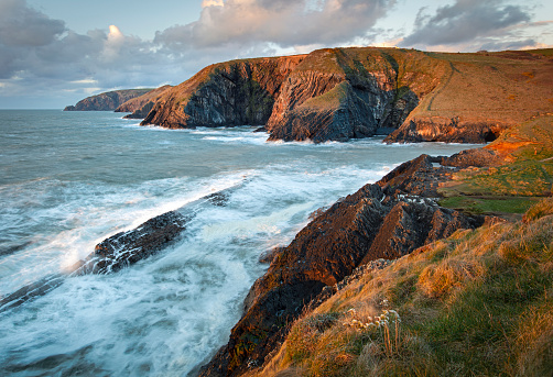 Dramatic cliffs and rough seas in Pembrokeshire national park, Wales