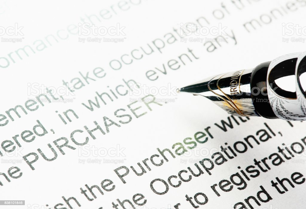 Pen about to sign legally binding sales document stock photo