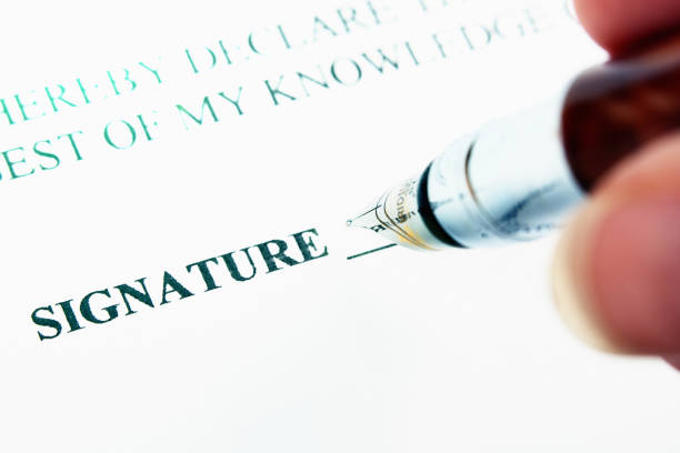 pen about to sign on the dotted line - deposition stock pictures, royalty-free photos & images