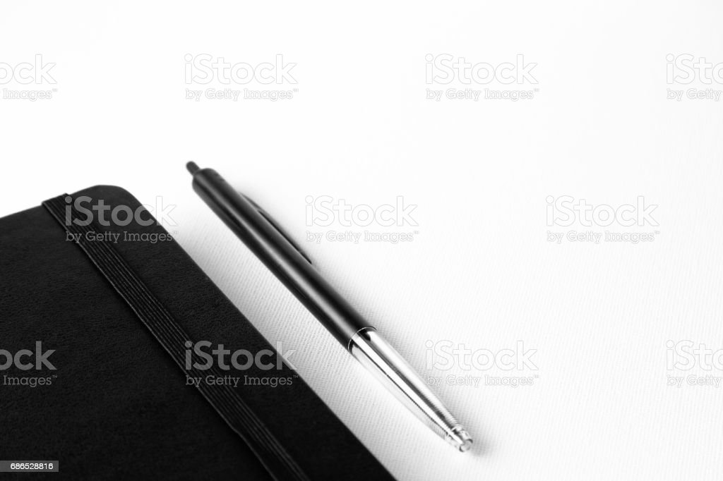 Pen an notepad isolated on a white canvas background with selective focusing on pen. zbiór zdjęć royalty-free