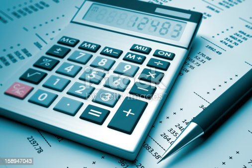 istock A pen and a calculator sit on a page with numbers 158947043
