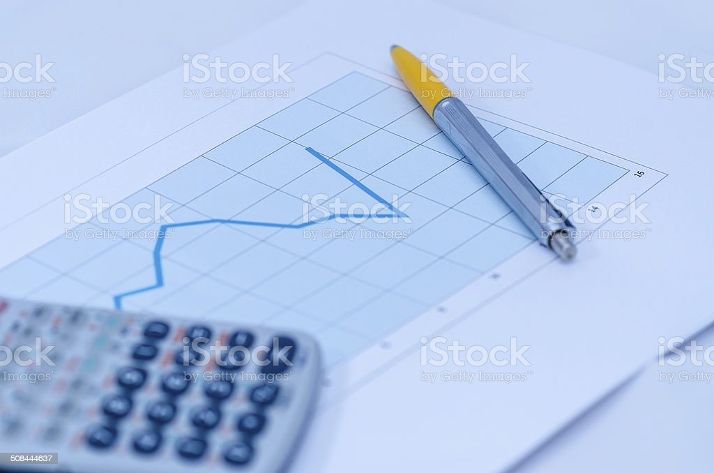 Pen and calculator on some document. royalty-free stock photo