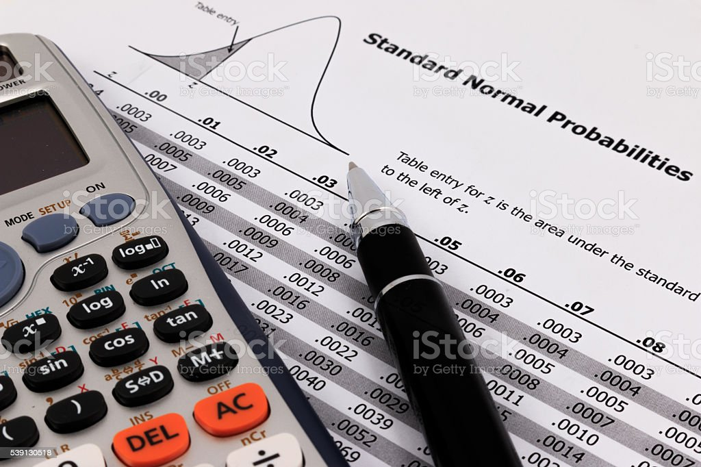 Pen and calculator on standard normal probabilities table. stock photo