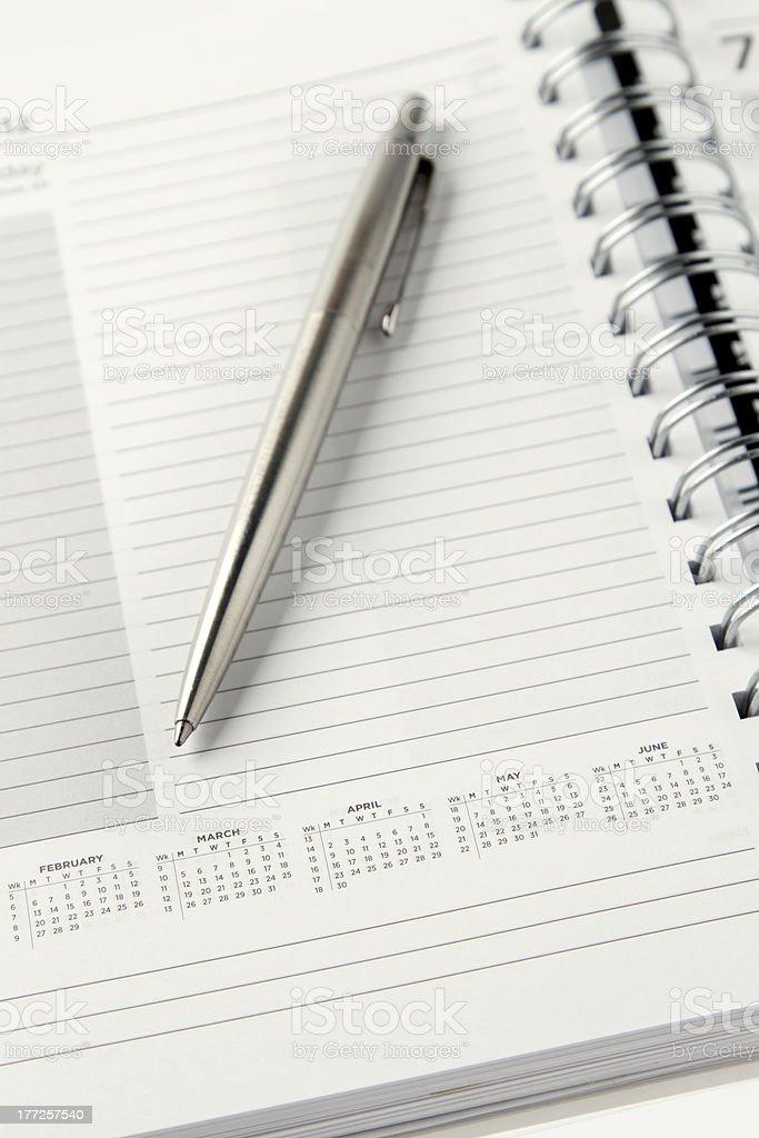 Pen and diary royalty-free stock photo