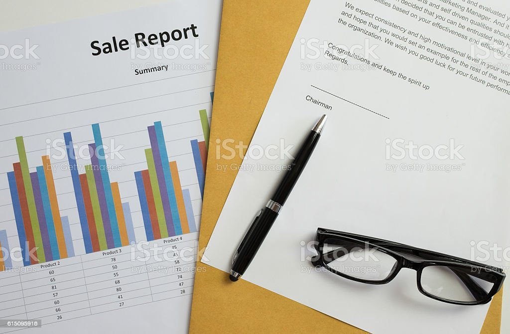 Pen and glasses on congratulations document stock photo