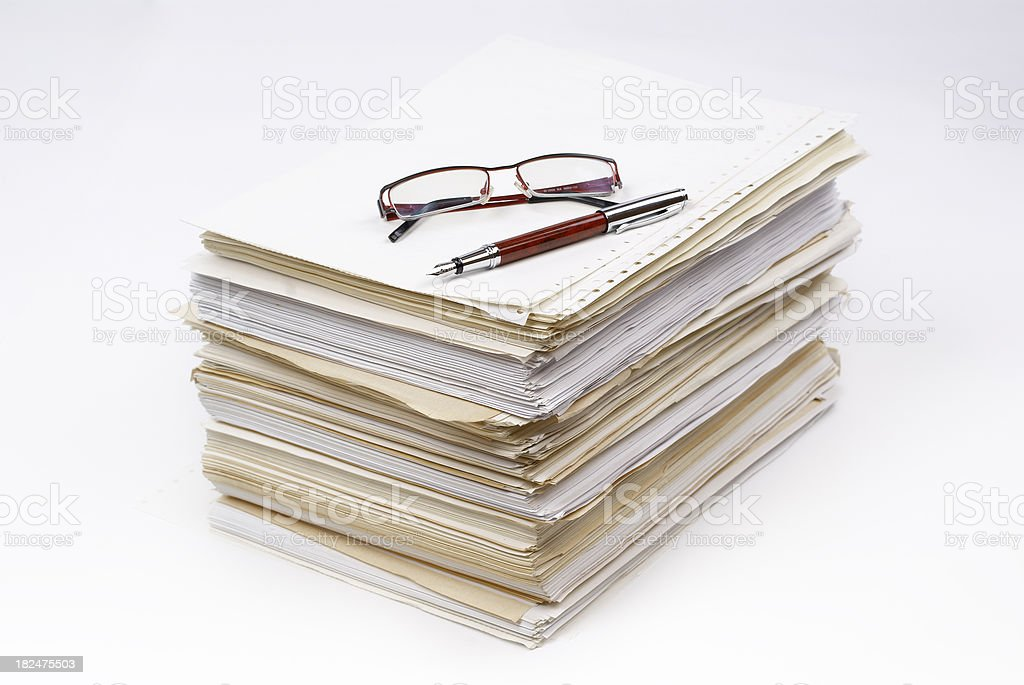 Pen and Glasses on the stack of papers royalty-free stock photo
