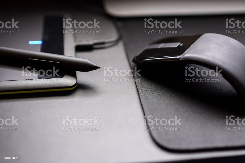 Pen and mouse stock photo