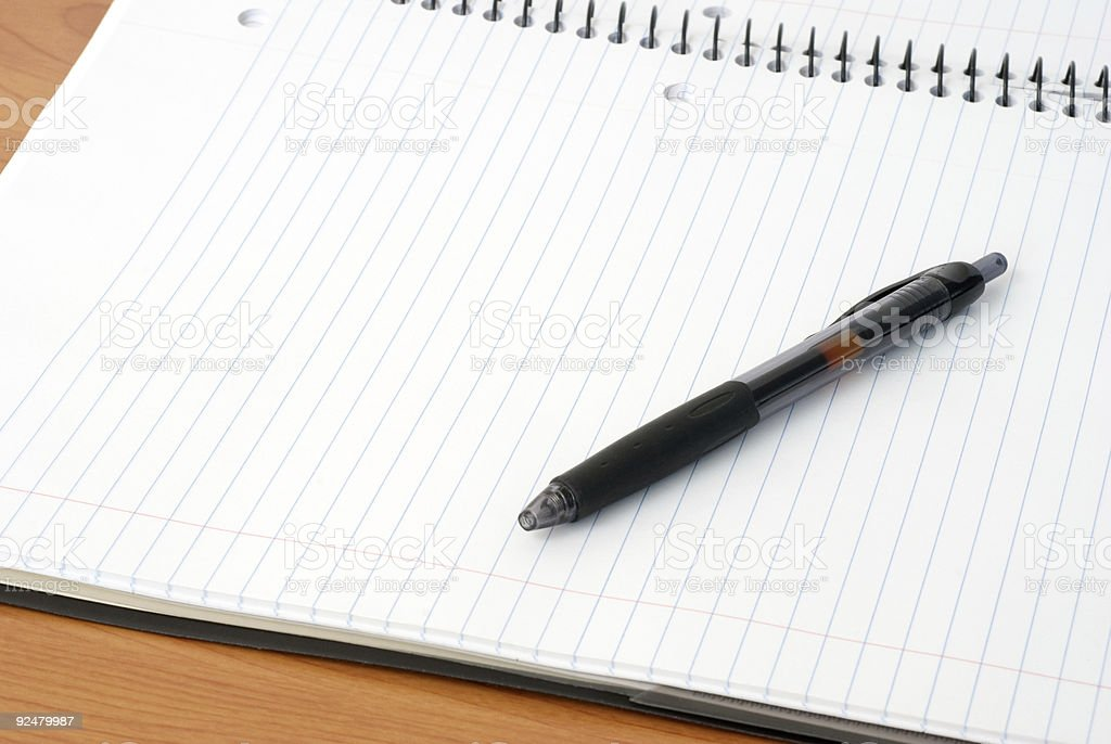 Pen and Notebook on a Desk royalty-free stock photo