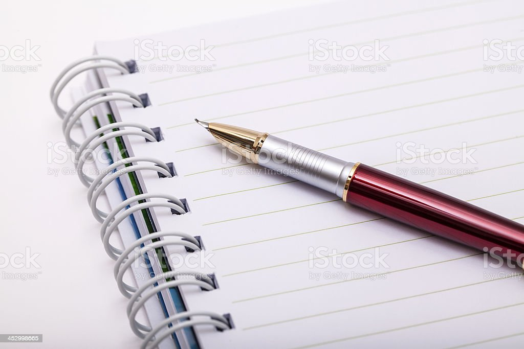 Pen and notebook royalty-free stock photo