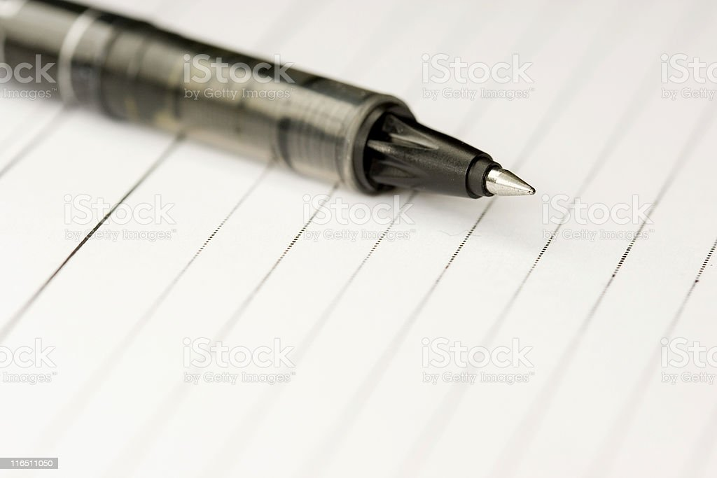 Pen and paper Image of a pen on a blank paper Acute Angle Stock Photo
