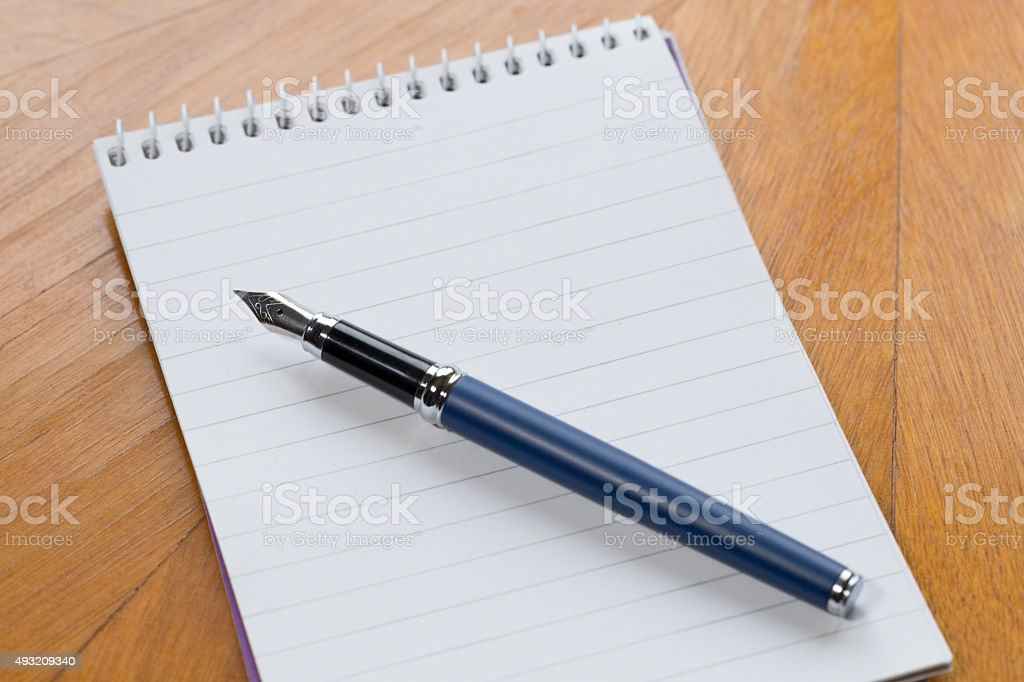 Pen and paper stock photo