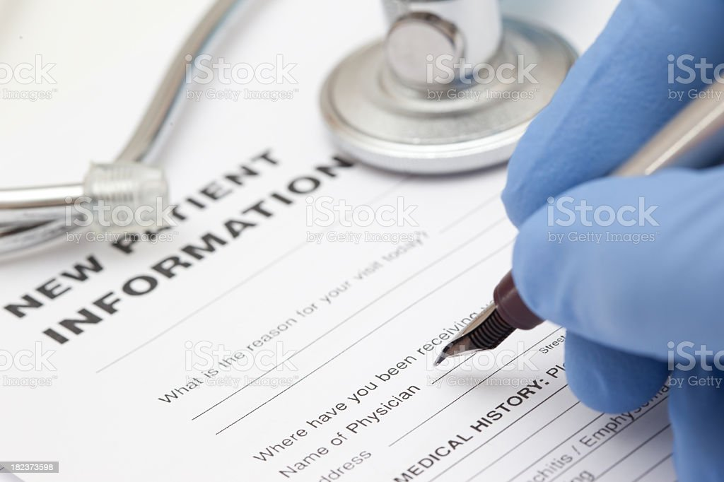 Pen and patient record form royalty-free stock photo