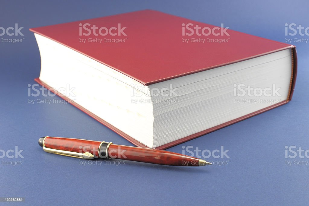 Pen and red book royalty-free stock photo