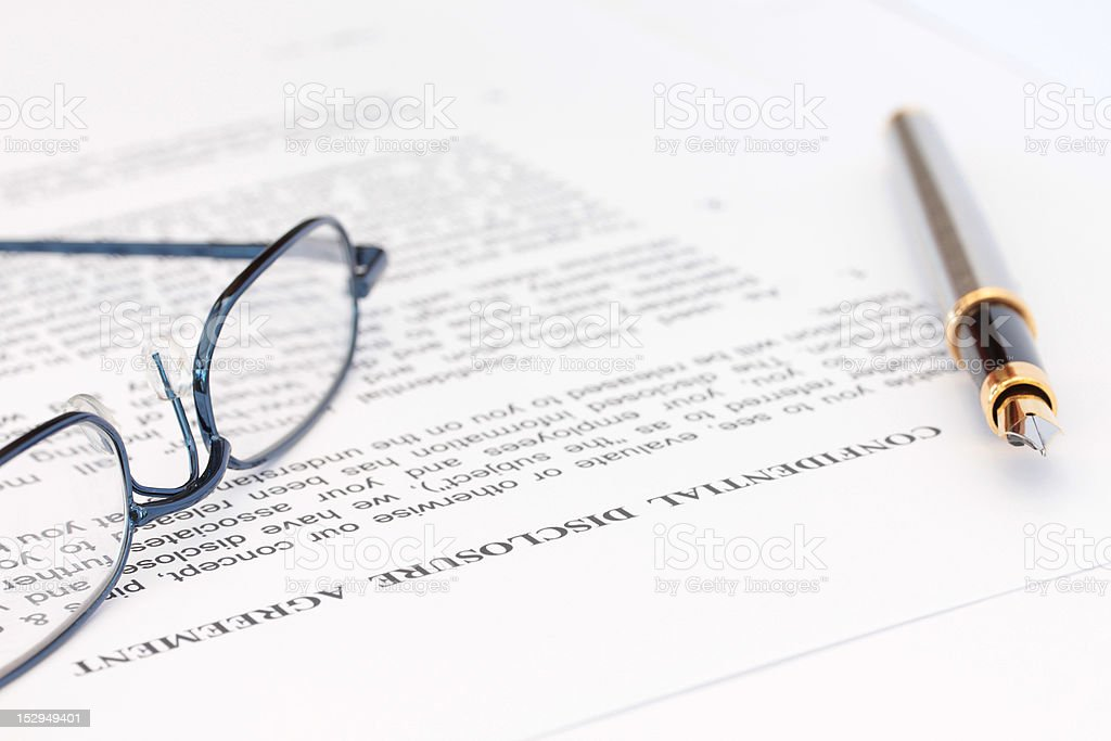 Pen and Spectacles with Disclosure Agreement royalty-free stock photo