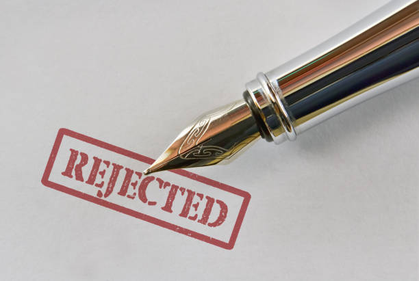Pen and word Rejected Closeup of a fountain pen and word Rejected on bright background rejection stock pictures, royalty-free photos & images