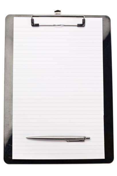 stylo en bas du bloc-note - au fond de photos et images de collection