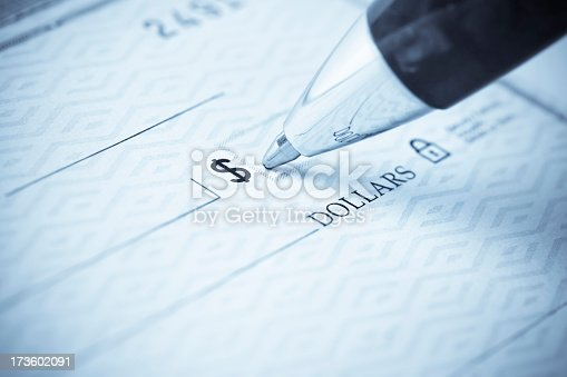 Writing a check.  Please visit my lightbox for more similar photos