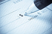istock Pen being used to write a check 173602091