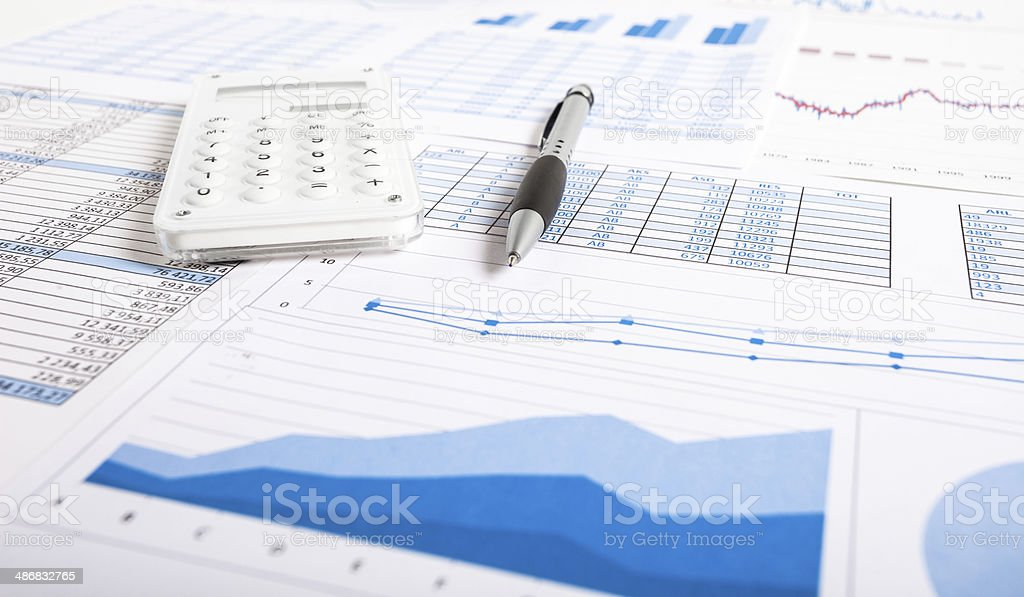 Pen, calculator and financial documents stock photo