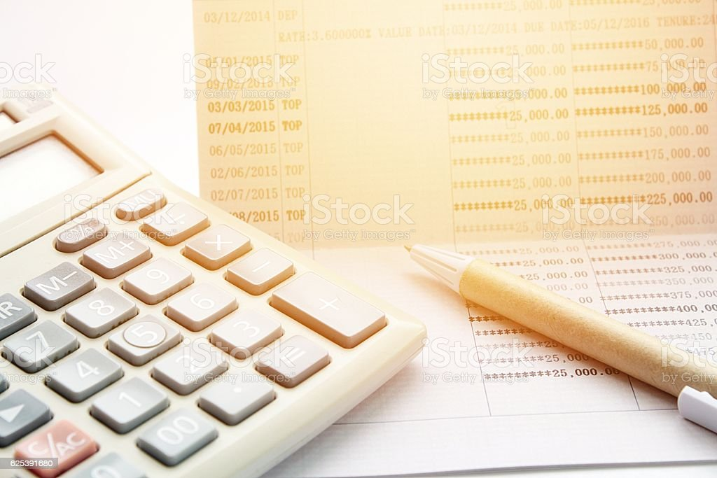 Pen Calculator And Savings Account Passbook On White Background