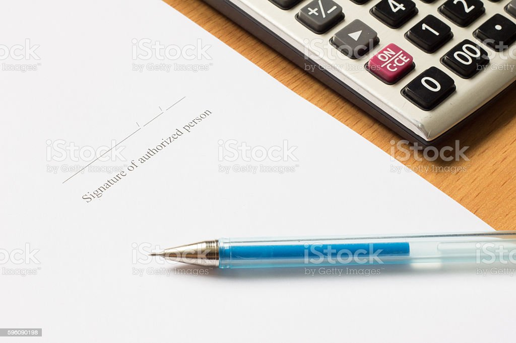 Pen, calculator on paper with Signature of authorized person wording stock photo
