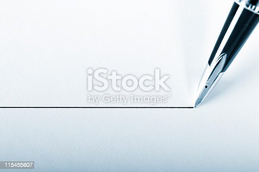 istock A pen drawing a precision point line on white paper 115455607
