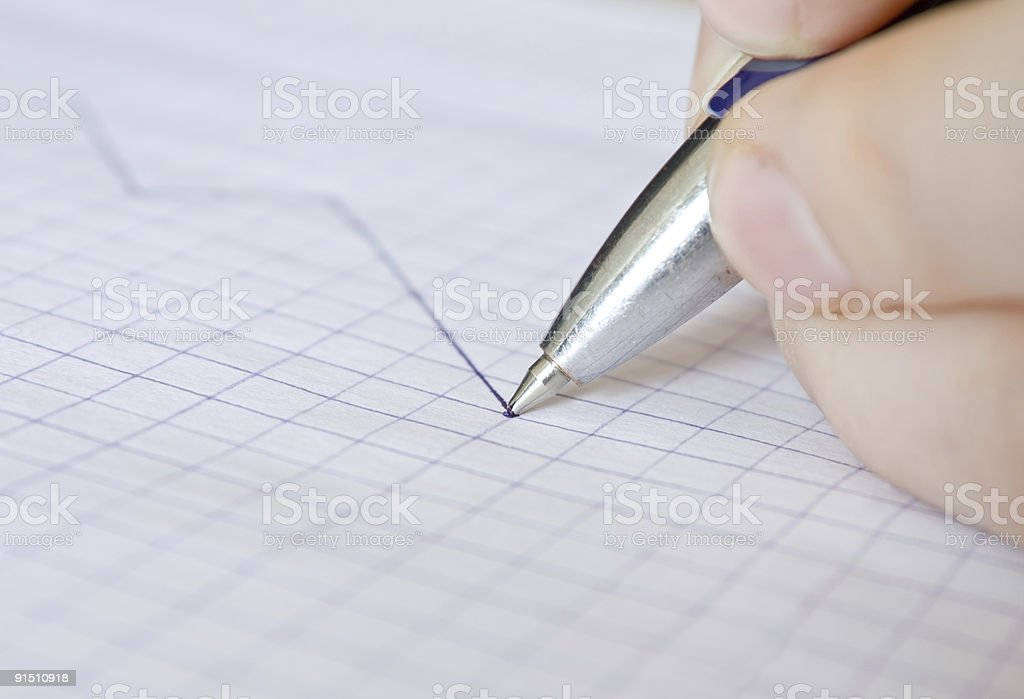 Pen drawing financial graph royalty-free stock photo