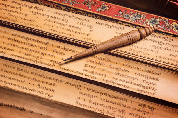 pen for writing text on Bai Lan background, Bai Lan or ancient palm leaf manuscripts content about buddhist scriptures, Pali language Khmer stock photo