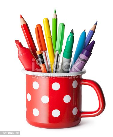 Pen holder with colored pens and pencils.
